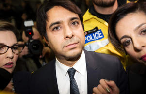 Canadian celebrity radio host Jian Ghomeshi leaves court after getting bail on multiple counts of sexual assault in Toronto November 26, 2014.  Ghomeshi, 47, former host of the internationally syndicated music and arts program Q on Canadian Broadcasting Corp radio, surrendered to police and was charged with four counts of sexual assault and one of choking, Toronto police said.