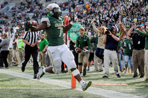 UAB running back Jordan Howard scores a touchdown against Marshall during the fourth quarter of an NCAA college football game, Saturday, Nov. 22, 2014, in Birmingham, Ala.