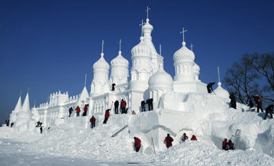 Visitors view a snow sculpture at Jingyuetan National Forest Park in Changchun, China, Dec. 24, 2012.