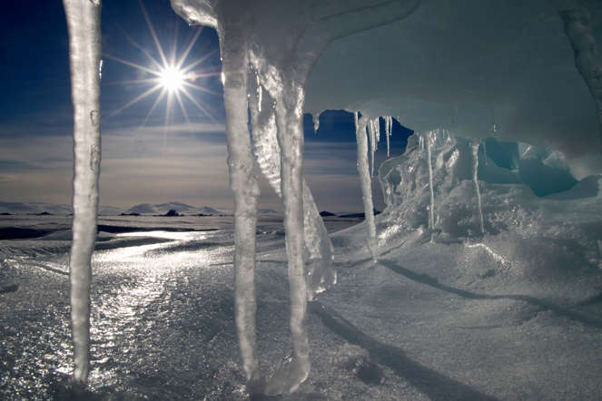 Icicles melting in the Arctic midnight sun, Baffin Bay, Canada.