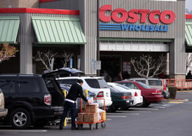A customer packs groceries into his car outside of a Costco store on March 6, 2014, in Richmond, Calif.