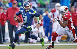 Quarterback Russell Wilson #3 of the Seattle Seahawks rushes against the Arizona Cardinals at CenturyLink Field on November 23, 2014 in Seattle, Washington.