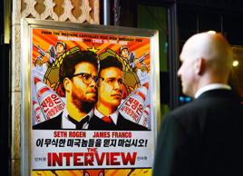 "A security guard stands at the entrance of United Artists theater during the premiere of the film ""The Interview"" in Los Angeles."