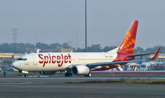 File: SpiceJet aircraft taxies on the runway at the airport in New Delhi, India