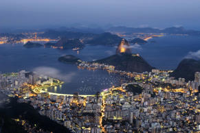 View of Sugarloaf Mountain in Rio de Janeiro during nightfall.