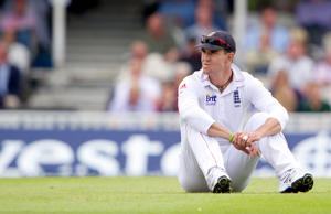 FILE - In this Saturday July 21, 2012 file photo, England's Kevin Pietersen sits on the pitch during the third day of the first cricket test match against South Africa at the Oval cricket ground, London.