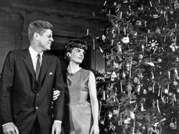 President John F,Kennedy and First Lady Jacqueline Kennedy admire the decorated Christmas tree pictured together at the White House in Washington.
