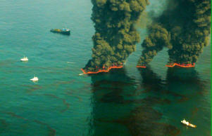 Smoke rises from a controlled burn May 19, 2010 in the Gulf of Mexico. According to reports May 20, 2010, Environmental Protection Agency (EPA) has ordered BP to use a less toxic chemical oil dispersant to break up the oil in the Gulf.