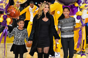 Vanessa Bryant, along with daughters Gianna Maria-Onore (left) and Natalia Diamante Bryant (right) bring out balloons to Kobe Bryant at a basketball game between the Los Angeles Lakers and the Oklahoma City Thunder on Dec. 19, 2014, in Los Angeles.