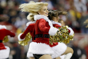 The San Francisco 49ers Gold Rush cheerleaders perform in Santa Claus costumes before the 49ers take on the San Diego Chargers at Levi's Stadium on December 20, 2014 in Santa Clara, California.