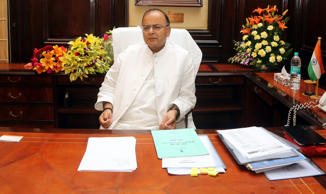 File: India's new Finance Minister Arun Jaitley looks on after taking the charge in his office at the ministry of finance, in New Delhi, India