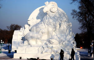 Workers put the finishing touch to a sculpture prior to the 27th Harbin Sun Island International Snow Sculpture Art Expo on December 20, 2014 in Harbin, China.