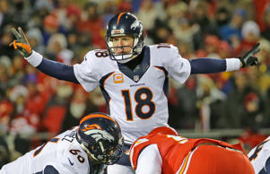 Denver Broncos quarterback Peyton Manning (18) calls a play in the first half of an NFL football game against the Kansas City Chiefs in Kansas City, Mo., Sunday, Nov. 30, 2014.