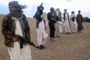 File: Taliban militia stand on a hillside at Maydan Shahr in Wardak province, west of Kabul
