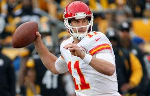Kansas City Chiefs quarterback Alex Smith (11) throws a pass during the first half of an NFL football game against the Pittsburgh Steelers in Pittsburgh, Sunday, Dec. 21, 2014.