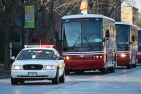 An Illinois State Police vehicle escorts University of Illinois team buses to Ryan Field on Saturday, Nov. 29, 2014, in Evanston, Ill.