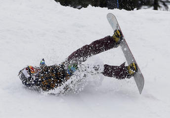 A snowboarder has a rough landing after attempting a jump at the Boreal Mountain Ski Resort near Donner Summit, Calif., Thursday, Dec. 4, 2014. A storm that swept over California on Dec. 3.