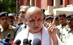 Pravin Togadia (centre) at the VHP event in Bhopal, Sunday. (Source: Express photo)