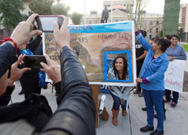 Erika Andiola gets her portrait taken at the Arizona State Capitol on Dec 17, 2014, in Phoenix, Ariz. Thousands of young immigrants moved a step closer to getting driver's licenses in Arizona when the U.S. Supreme Court on Wednesday rebuffed the governor's latest attempt to deny them the privilege.