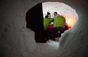 A young couple are about to sleep in an igloo on February 23, 2013 in a village of igloos at the Le Semnoz village, French Alps. Philippe Desmazes/AFP/Getty Images