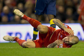 Liverpool's Martin Skrtel reacts after a collision with Arsenal's Olivier Giroud during the English Premier League soccer match between Liverpool and Arsenal at Anfield Stadium, Liverpool, England, Sunday Dec. 21, 2014.