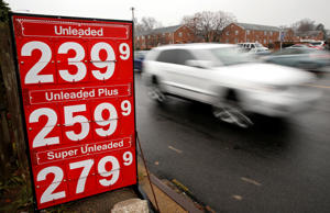 A car passes a gas station sign reflecting the dip in fuel prices in Falls Church, Virginia December 16, 2014. For the first time in more than a decade, U.S. gasoline prices are tumbling toward $2 a gallon even as the economy grows and unemployment shrinks, a constellation that will test the theory that domestic fuel demand is in terminal decline. Conventional wisdom holds that structural changes such as increased fuel efficiency, greater urbanization and a graying population that have taken hold since the financial crisis will temper any potential pick-up in U.S. fuel consumption next year, despite the unanticipated arrival of half-priced fuel.
