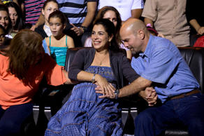 "Gerardo Hernandez, right, member of ""The Cuban Five,"" touches the belly of his pregnant wife Adriana Perez, during a concert of singer Silvio Rodriguez in Havana, Cuba, Saturday, Dec. 20, 2014."