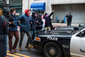 Protestors block police cruisers on Ontario Street December 21, 2014, in Cleveland, Ohio. Demonstrators marched through downtown protesting the death of 12-year old Tamir Rice.