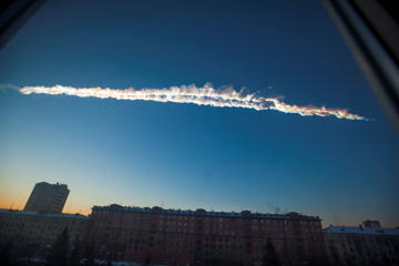 In this Friday, Feb. 15, 2013, file photo, provided by Chelyabinsk.ru, a meteorite contrail is seen over Chelyabinsk. The United Nations has approved steps to ward off space-based threats that have seized the public imagination thanks to Hollywood films. Rogue asteroids, comets or meteors pose a real global threat, highlighted by the meteorite cluster that blazed across the skies of Russia's southern Urals in February. More than 1,600 people were injured by the shock wave from the explosion as it hit near the city of Chelyabinsk, estimated to be as strong as 20 Hiroshima atomic bombs.