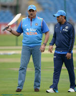 LEEDS, ENGLAND - SEPTEMBER 04:  Mahendra Singh Dhoni of India speaks with Director of Cricket Ravi Shastri during a nets session at Headingley on September 4, 2014 in Leeds, England.