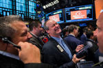"Traders work on the floor as they wait for a final price on the Alibaba Group Holding Ltd. initial public offering (IPO) under the ticker ""BABA"", at the New York Stock Exchange in New York September 19, 2014. Alibaba Group Holding Ltd's shares surged by more than 40 percent in their first day of trading on Friday as investors jumped in to buy what looks likely to be the largest IPO in history. REUTERS/Lucas Jackson (UNITED STATES - Tags: BUSINESS SCIENCE TECHNOLOGY TPX IMAGES OF THE DAY)"