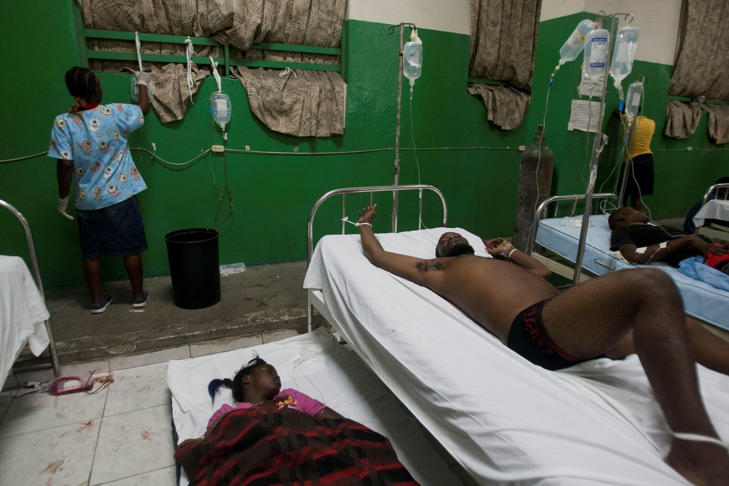 People injured during carnival celebrations lie down as they wait for treatment at the emergency room of the General Hospital in Port-au-Prince, Haiti, early Tuesday, Feb. 17, 2015. At least 18 people on a music group's packed Carnival float in the Haitian capital were killed Tuesday when they were electrocuted by a power line, officials said. The accident occurred as thousands of people filled the streets of downtown Port-au-Prince for the raucous annual celebration.