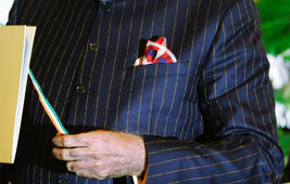 "File: A close-up view of Indian Prime Minister Narenda Modi's dark pinstripe suit, repeatedly embroidered with the words ""Narendra Damodardas Modi"", as he talks to U.S. President Barack Obama while walking through the garden at Hyderabad House in New Delhi January 25, 2015."