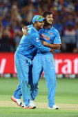 Suresh Raina and Mohit Sharma of India celebrate after Sharma got the wicket of Yasir Shah of Pakistan during the 2015 ICC Cricket World Cup match between India and Pakistan at Adelaide Oval on February 15, 2015 in Adelaide, Australia.