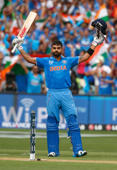 India's batsman Virat Kohli acknowledges the crowd upon scoring a century during their Cricket World Cup match against Pakistan in Adelaide, February 15, 2015.
