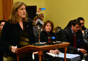 Julie Burkhart, CEO of the Trust Women Foundation abortion-rights group, speaks during a Kansas Senate committee hearing against a bill banning a procedure used in 8 percent of the abortions performed in Kansas, Monday, Feb. 2, 2015, at the Statehouse in Topeka, Kan. Burkhart says the measure would be challenged in court if enacted.