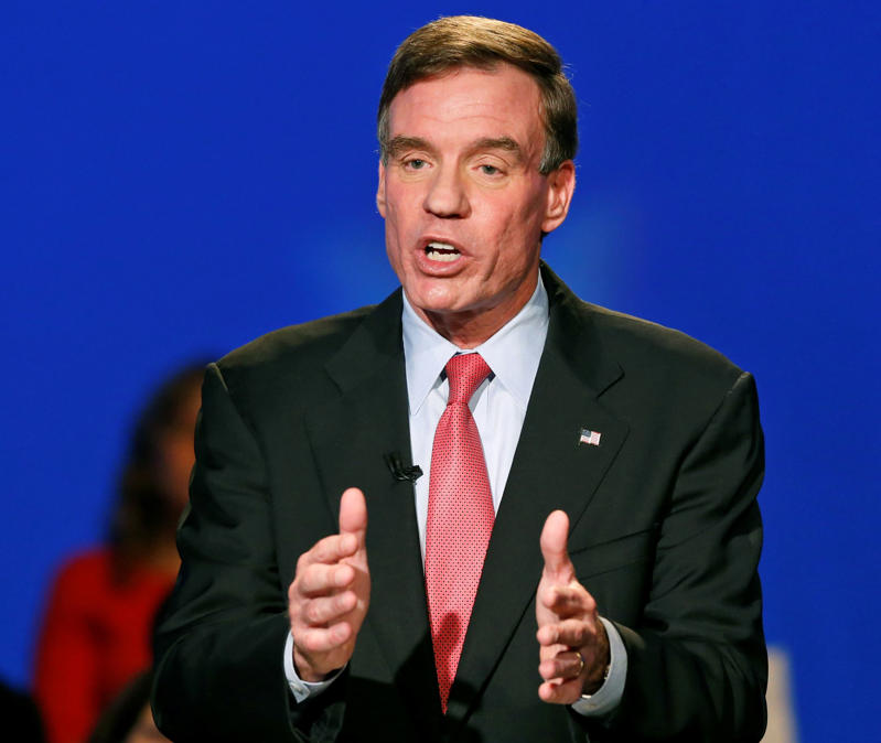 US Sen. Mark Warner, D-Va. gestures during his debate with Republican challenger, Ed Gillespie, in Richmond, Va., Monday, Oct. 13, 2014.  Steve Helber/AP