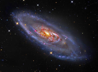 What's happening at the center of spiral galaxy M106? A swirling disk of stars and gas, M106's appearance is dominated by blue spiral arms and red dust lanes near the nucleus, as shown in the featured image. The core of M106 glows brightly in radio waves and X-rays where twin jets have been found running the length of the galaxy. An unusual central glow makes M106 one of the closest examples of the Seyfert class of galaxies, where vast amounts of glowing gas are thought to be falling into a central massive black hole.