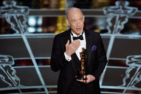 "HOLLYWOOD, CA - FEBRUARY 22:  Actor J.K. Simmons accepts the Actor in a Supporting Role Award for ""Whiplash"" onstage during the 87th Annual Academy Awards at Dolby Theatre on February 22, 2015 in Hollywood, California.  (Photo by Kevin Winter/Getty Images)"