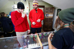 In this Dec. 11, 2014 photo, two customers from Texas smell strains of marijuana, inside the soon-to-move out Breckenridge Cannabis Club, which sells recreational marijuana products, located on the main commercial street that runs through the ski town of Breckenridge, Colo.