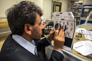 A forensic scientist practises classifying fingerprints at the fingerprint department at Punjab Forensic Science Agency in Lahore January 13, 2015.