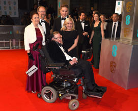 Stephen Hawking, centre, his former wife Jane Wilde, left and daughter Lucy Hawking, centre right, arrive for the BAFTAs earlier this month.