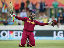 West Indies batsman Chris Gayle celebrates after scoring a double century during their Cricket World  Cup Pool B match against Zimbabwe in Canberra, Australia, Tuesday, Feb. 24, 2015.