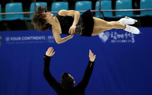 Meagan Duhamel and Eric Radford of Canada perform during the pairs free skating in the ISU Four Continents Figure Skating Championships in Seoul, South Korea, Saturday, Feb. 14, 2015.