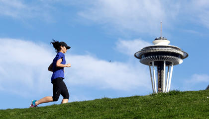 The Space Needle is visible behind a runner on a warm day in Seattle, February 17, 2015.