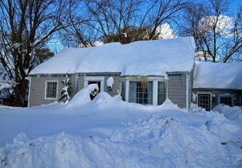 A snow covered house in Orchard Park, New York.