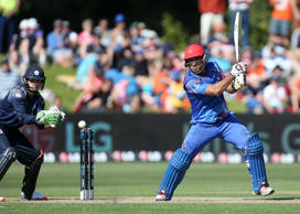Afghanistan's Samiullah Shenwari bats as Scotland wicketkeeper Matt Cross, left, watches during their Cricket World Cup Pool A match in Dunedin, New Zealand, Thursday, Feb. 26, 2015.
