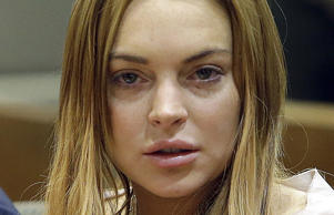 Actress Lindsay Lohan sits at a hearing in Los Angeles Superior Court in Los Angeles, California.
