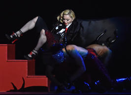 Singer Madonna falls during her performance at the BRIT music awards at the O2 Arena in Greenwich