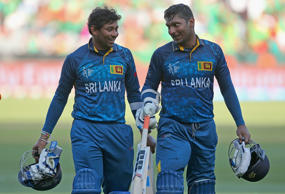 Tillakaratne Dilshan and Kumar Sangakkara of Sri Lanka walk off the field during the 2015 ICC Cricket World Cup match between Sri Lanka and Bangladesh at Melbourne Cricket Ground on February 26, 2015 in Melbourne, Australia.